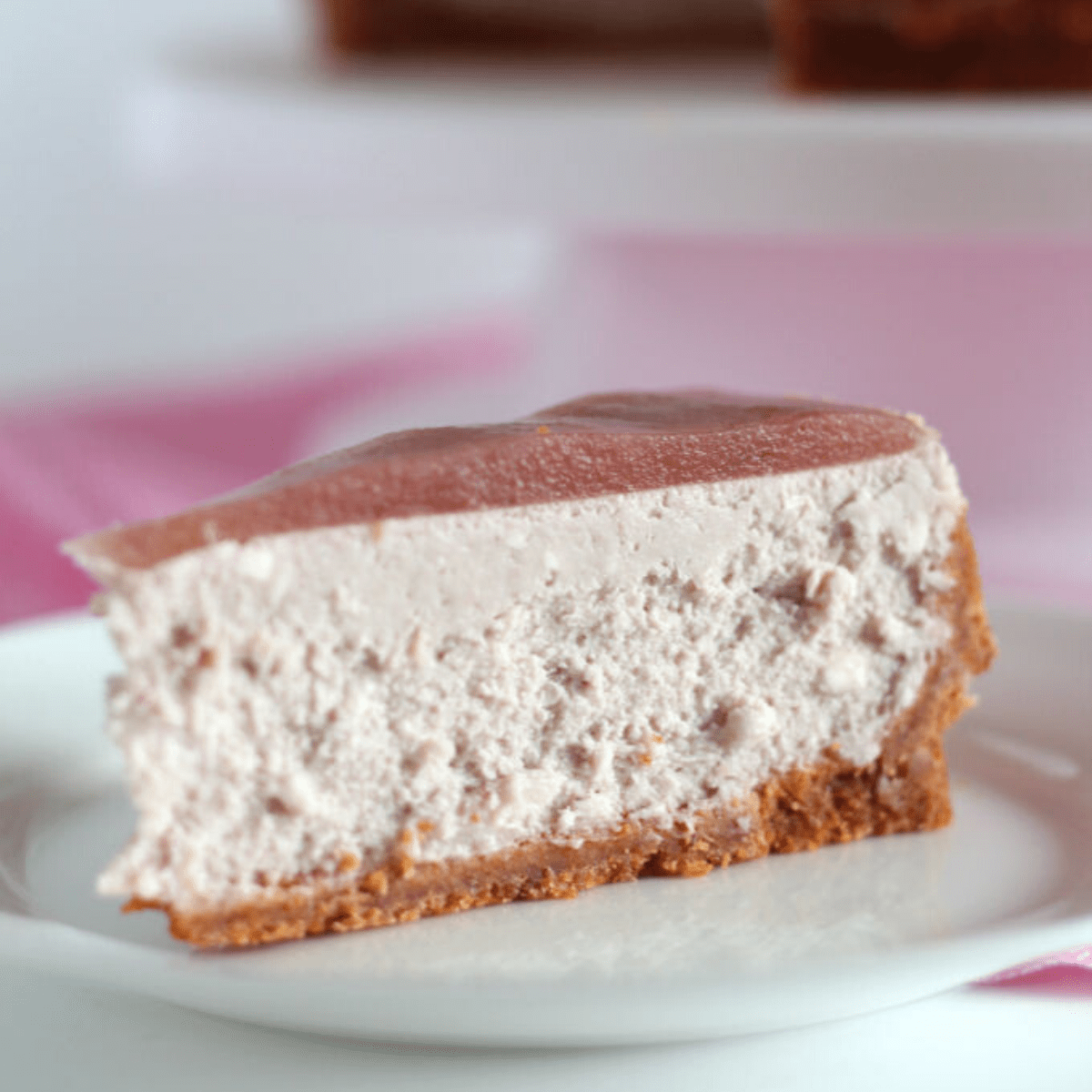 A slice of cheesecake on a plate.