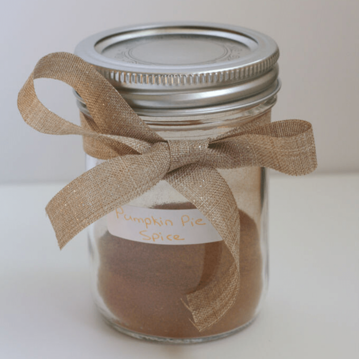 Spice in a mason jar with a bow around it.