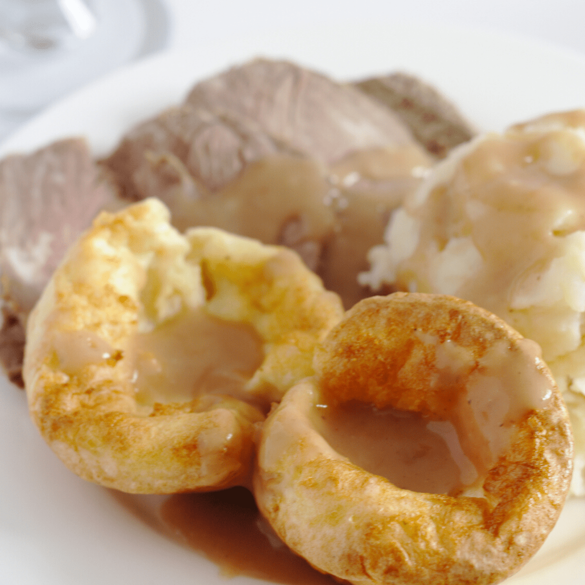 Yorkshire Puddings on a dinner plate.