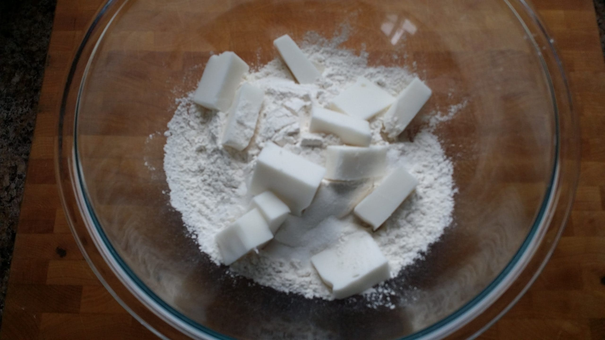 shortening in a bowl of flour, sugar and salt.